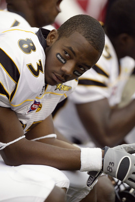 SEATTLE - SEPTEMBER 17:  Wide receiver Xavier Jackson #83 of the Grambling State University Tigers looks on as he sits on a sideline bench during a NCAA game against the Washington State University Cougars at Quest Field on September 17, 2005 in Seattle W