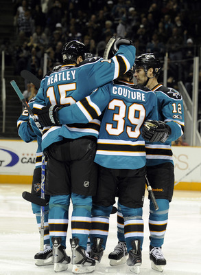 SAN JOSE, CA - NOVEMBER 6:  Logan Couture #39 of the San Jose Sharks celebrates his 5th goal of the year with teammates Patrick Marleau #12 and Dany Heatley #15 against Tampa Bay Lightning during an NHL hockey game at the HP Pavilion on November 6, 2010 i
