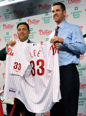 PHILADELPHIA - DECEMBER 15:  Pitcher Cliff Lee (R) #33 of the Philadelphia Phillies is introduced to the media and presented his jersey by the Philadelphia Phillies general manager Ruben Amaro Jr. during a press conference at Citizens Bank Park on Decembe