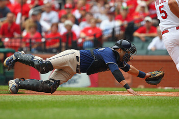 ST. LOUIS - SEPTEMBER 19: Yorvit Torrealba #8 of the San Diego Padres attempts to tag out Albert Pujols #5 of the St. Louis Cardinals at Busch Stadium on September 19, 2010 in St. Louis, Missouri.  The Cardinals beat the Padres 4-1.  (Photo by Dilip Vishw