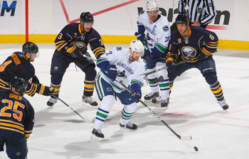 BUFFALO, NY - NOVEMBER 15: Daniel Sedin #22 and Henrik Sedin #33 of the Vancouver Canucks skate against  the Buffalo Sabres  at HSBC Arena on November 15, 2010 in Buffalo, New York. Buffalo won 4-3 in overtime.  (Photo by Rick Stewart/Getty Images)
