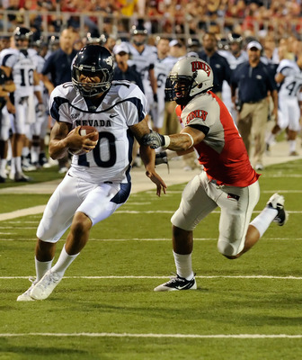 LAS VEGAS - OCTOBER 02:  Quarterback Colin Kaepernick #10 of the Nevada Reno Wolf Pack gets away from Mike Clausen #6 of the UNLV Rebel en route to scoring a touchdown in the first quarter of their game at Sam Boyd Stadium October 2, 2010 in Las Vegas, Ne