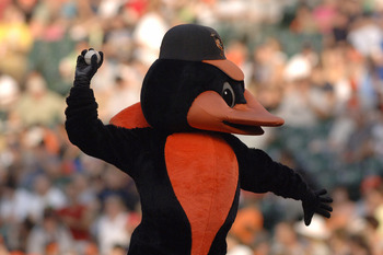Baltimore Orioles mascot tosses a ball before play  against the Chicago White Sox  July 28, 2006 in Baltimore, Maryland.  The Sox won 6 - 4 on a ninth inning grand slam home run. (Photo by A. Messerschmidt/Getty Images) *** Local Caption ***