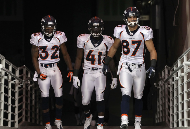GLENDALE, AZ - DECEMBER 12: (L-R) Perrish Cox #32, Cassius Vaughn #41 and Eric Decker #87 of the Denver Broncos run out onto the field before the NFL game against the Arizona Cardinals at the University of Phoenix Stadium on December 12, 2010 in Glendale,