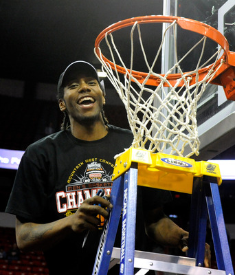 LAS VEGAS - MARCH 13:  Kawhi Leonard #15 of the San Diego State Aztecs smiles as he gets ready to cut down the net after defeating the UNLV Rebels 55-45 in the championship game of the Conoco Mountain West Conference Basketball tournament at the Thomas &