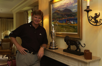 SURREY - JULY 26:  Ernie Els of South Africa the 2002 Open Champion with the Open trophy at his home in Surrey, England  on July 26, 2002. (Photo by Stephen Munday/Getty Images)