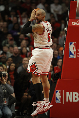 CHICAGO, IL - DECEMBER 10: Carlos Boozer #5 of the Chicago Bulls grabs a rebound against the Los Angeles Lakers at the United Center on December 10, 2010 in Chicago, Illinois. The Bulls defeated the Lakers 88-84. NOTE TO USER: User expressly acknowledges