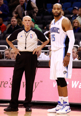 ORLANDO, FL - DECEMBER 06:  Vince Carter #15 of the Orlando Magic stands with referee Dick Bavetta #27 during the game against the Atlanta Hawks at Amway Arena on December 6, 2010 in Orlando, Florida. NOTE TO USER: User expressly acknowledges and agrees t