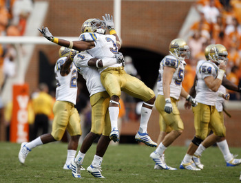 KNOXVILLE, TN - SEPTEMBER 12: Rahim Moore #3 and Alterraun Verner #1 of the UCLA Bruins celebrate at the end of the game against the Tennessee Volunteers on September 12, 2009 at Neyland Stadium in Knoxville, Tennessee. The Bruins beat the Volunteers 19-1