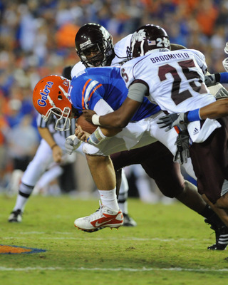 GAINESVILLE, FL - OCTOBER 16:  Quarterback John Brantley #12 of the Florida Gators is sacked by the Mississippi State Bulldogs October 16, 2010 Ben Hill Griffin Stadium at Gainesville, Florida.  (Photo by Al Messerschmidt/Getty Images)