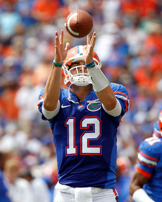 GAINESVILLE, FL - SEPTEMBER 04:  Quarterback John Brantley #12 of the Florida Gators catches a pass prior to the game against the Miami University RedHawks at Ben Hill Griffin Stadium on September 4, 2010 in Gainesville, Florida.  (Photo by Sam Greenwood/