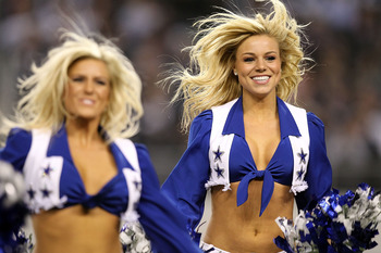 ARLINGTON, TX - DECEMBER 12:  A Dallas Cowboys cheerleader performs at Cowboys Stadium on December 12, 2010 in Arlington, Texas.  (Photo by Ronald Martinez/Getty Images)