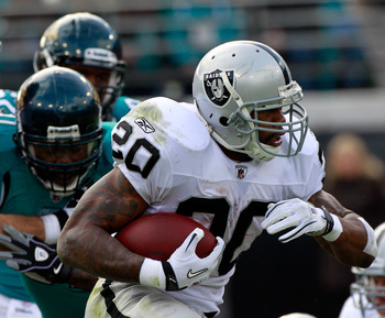 JACKSONVILLE, FL - DECEMBER 12:  Darren McFadden #20 of the Oakland Raiders runs for yardage during the game against the Jacksonville Jaguars at EverBank Field on December 12, 2010 in Jacksonville, Florida.  (Photo by Sam Greenwood/Getty Images)