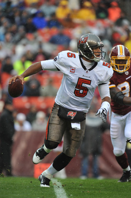 LANDOVER, MD - DECEMBER 12:  Josh Freeman #5 of the Tampa Bay Buccaneers scrambles during the game against the Washington Redskins  at FedExField on December 12, 2010 in Landover, Maryland. The Buccaneers defeated the Redskins 17-16. (Photo by Larry Frenc