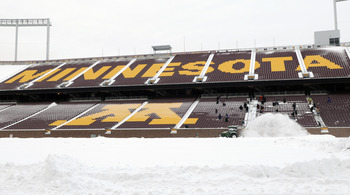MINNEAPOLIS, MN - DECEMBER 15: Workers shovel snow from the stands as TCF Bank Stadium prepares for a potential monday night football game between the Minnesota Vikings and Chicago Bears on December 15, 2010 in Minneapolis, Minnesota. Preparations are due