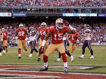 SAN FRANCISCO - NOVEMBER 14:  Michael Crabtree #15 of the San Francisco 49ers celebrates after scoring a touchdown against the St. Louis Rams at Candlestick Park on November 14, 2010 in San Francisco, California.  (Photo by Ezra Shaw/Getty Images)