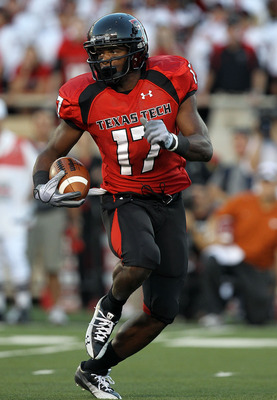 LUBBOCK, TX - SEPTEMBER 18:  Detron Lewis #17 of the Texas Tech Red Raiders runs the ball against the Texas Longhorns at Jones AT&T Stadium on September 18, 2010 in Lubbock, Texas.  (Photo by Ronald Martinez/Getty Images)