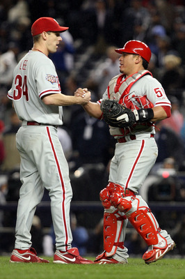 NEW YORK - OCTOBER 28:  (L-R) Cliff Lee #34 and Carlos Ruiz #51 of the Philadelphia Phillies celebrate after their 6-1 win against the New York Yankees in Game One of the 2009 MLB World Series at Yankee Stadium on October 28, 2009 in the Bronx borough of