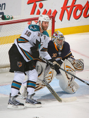 BUFFALO, NY - DECEMBER 09:  Joe Thornton #19 of the San Jose Sharks looks to make a play against Ryan Miller #30 of the Buffalo Sabres  at HSBC Arena on December 9, 2010 in Buffalo, New York. Buffalo won 6-3.  (Photo by Rick Stewart/Getty Images)