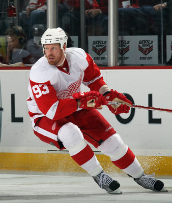 NEWARK, NJ - DECEMBER 11:  Johan Franzen #93 of the Detroit Red Wings skates against the New Jersey Devils at the Prudential Center on December 11, 2010 in Newark, New Jersey. The Red Wings defeated the the Devils 4-1.  (Photo by Bruce Bennett/Getty Image