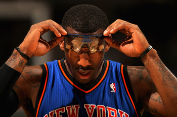DENVER - NOVEMBER 16:  Amar'e Stoudemire #1 of the New York Knicks adjusts his glasses as he faces the Denver Nuggets at the Pepsi Center on November 16, 2010 in Denver, Colorado. NOTE TO USER: User expressly acknowledges and agrees that, by downloading a