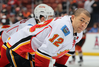 ANAHEIM, CA - DECEMBER 10:  Jerome Iginla #12 of the Calgary Flames looks on prior to the start of the game against the Anaheim Ducks at the Honda Center on December 10, 2010 in Anaheim, California.  (Photo by Jeff Gross/Getty Images)