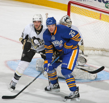 BUFFALO, NY - DECEMBER 11:  Alex Goligoski #3 of the Pittsburgh Penguins defends against Thomas Vanek #26 of the Buffalo Sabres  at HSBC Arena on December 11, 2010 in Buffalo, New York. Pittsburgh won 5-2.  (Photo by Rick Stewart/Getty Images)