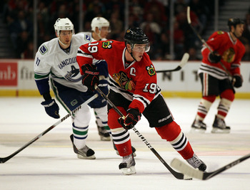 CHICAGO, IL - DECEMBER 03: Jonathan Toews #19 of the Chicago Blackhawks skates up the ice past Ryan Kesler #17 of the Vancouver Canucks at the United Center on December 3, 2010 in Chicago, Illinois. The Canucks defeated the Blackhawks 3-0. (Photo by Jonat