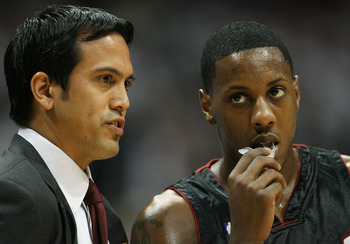 ATLANTA - APRIL 29:  Head coach Erik Spoelstra talks with Mario Chalmers #6 of the Miami Heat while taking on the Atlanta Hawks during Game Five of the Eastern Conference Quarterfinals at Philips Arena on April 29, 2009 in Atlanta, Georgia. NOTE TO USER: