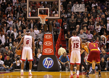 MIAMI, FL - DECEMBER 15:  LeBron James #6 of the Miami Heat shoots a foul shot as a fan holds a sign saying 'He's in Miami' during a game against the Cleveland Cavaliers at American Airlines Arena on December 15, 2010 in Miami, Florida. NOTE TO USER: User