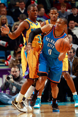 NEW ORLEANS, LA - DECEMBER 10:  Russell Westbrook #0 of the Oklahoma City Thunder passes the ball around Chris Paul #3 of the New Orleans Hornets  at New Orleans Arena on December 10, 2010 in New Orleans, Louisiana.    The Thunder defeated the Hornets 97-