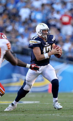 SAN DIEGO - DECEMBER 12:  Quarterbaqck Philip Rivers #17 of the San Diego Chargers eludes a tackle in the game against the Kansas City Chiefs at Qualcomm Stadium on December 12, 2010 in San Diego, California.  the Chargers won 31-0.  (Photo by Stephen Dun