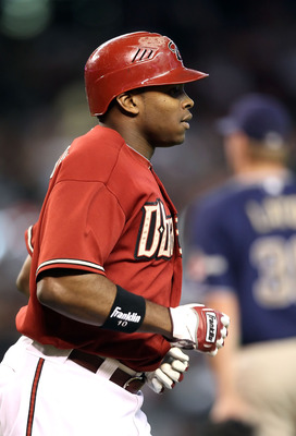 PHOENIX - AUGUST 08:  Justin Upton #10 of the Arizona Diamondbacks runs to first base during the Major League Baseball game against the San Diego Padres at Chase Field on August 8, 2010 in Phoenix, Arizona.  (Photo by Christian Petersen/Getty Images)