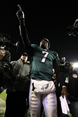 PHILADELPHIA, PA - DECEMBER 02:  Michael Vick #7 of the Philadelphia Eagles celebrates as he walks off the field after the Eagles won 34-24 against the Houston Texans at Lincoln Financial Field on December 2, 2010 in Philadelphia, Pennsylvania.  (Photo by