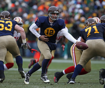 GREEN BAY, WI - DECEMBER 05: Aaron Rodgers #12 of the Green Bay Packers turns to hand off against the San Francisco 49ers at Lambeau Field on December 5, 2010 in Green Bay, Wisconsin. The Packers defeated the 49ers 34-16. (Photo by Jonathan Daniel/Getty I
