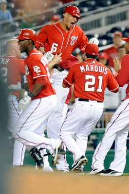WASHINGTON - AUGUST 26:  Ian Desmond #6 of the Washington Nationals is mobbed by teammates after driving in the game winning run in the thirteenth inning against the St. Louis Cardinals at Nationals Park on August 26, 2010 in Washington, DC.  The National
