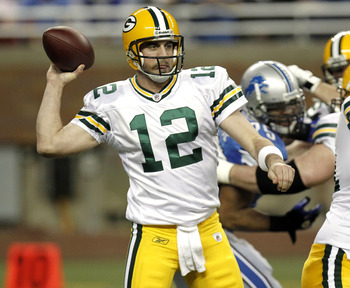 DETROIT, MI - DECEMBER 12:  Aaron Rodgers #12 of the Green Bay Packers throws a second quarter pass while playing the Detroit Lions on December 12, 2010 at Ford Field in Detroit, Michigan.  (Photo by Gregory Shamus/Getty Images)