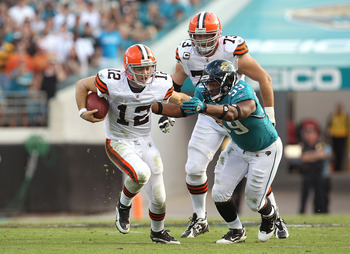 JACKSONVILLE, FL - NOVEMBER 21:  Colt McCoy #12  of the Cleveland Browns is chased down by Larry Hart #59  during a game agaisnt the Jacksonville Jaguars at EverBank Field on November 21, 2010 in Jacksonville, Florida.  (Photo by Mike Ehrmann/Getty Images