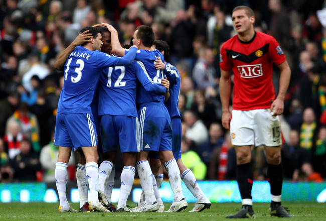 MANCHESTER, ENGLAND - APRIL 03:  The Chelsea players celebrate at the end of the Barclays Premier League match between Manchester United and Chelsea at Old Trafford on April 3, 2010 in Manchester, England.  (Photo by Alex Livesey/Getty Images)