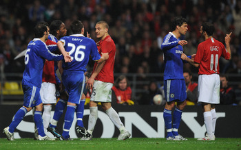 MOSCOW - MAY 21:  John Terry and Didier Drogba of Chelsea argues with Nemanja Vidic of Manchester Unirted during the UEFA Champions League Final match between Manchester United and Chelsea at the Luzhniki Stadium on May 21, 2008 in Moscow, Russia.  (Photo