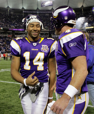 MINNEAPOLIS, MN - DECEMBER 05:  Brett Favre #4 of the Minnesota Vikings talks with teammate Joe Webb #14 as they leave the field after defeating the Buffalo Bills at the Mall of America Field at the Hubert H. Humphrey Metrodome on December 5, 2010 in Minn