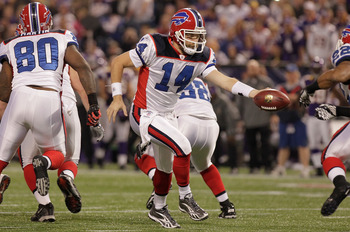 MINNEAPOLIS, MN - DECEMBER 05:  Ryan Fitzpatrick #14 of the Buffalo Bills hands the ball off against the Minnesota Vikings at the Mall of America Field at the Hubert H. Humphrey Metrodome on December 5, 2010 in Minneapolis, Minnesota.  (Photo by Nick Laha