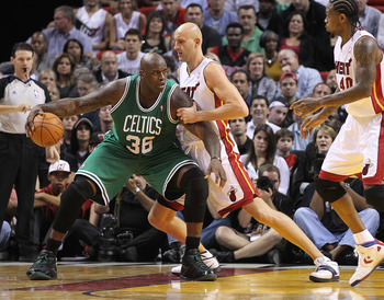 MIAMI - NOVEMBER 11:  Shaquille O'Neal #36 of the Boston Celtics is guarded by Zydrunas Ilgauskas #11 during a game against the Miami Heat at American Airlines Arena on November 11, 2010 in Miami, Florida. NOTE TO USER: User expressly acknowledges and agr