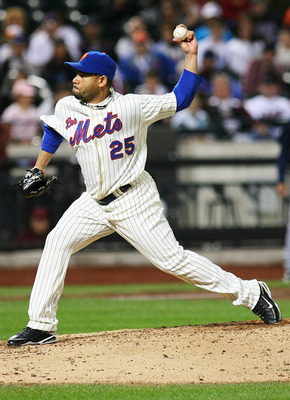 NEW YORK - SEPTEMBER 17:  Pedro Feliciano #25 of the New York Mets pitches against the Atlanta Braves on September 17, 2010 at Citi Field in the Flushing neighborhood of the Queens borough of New York City. The Braves beat the Mets 6 - 4.  (Photo by Andre