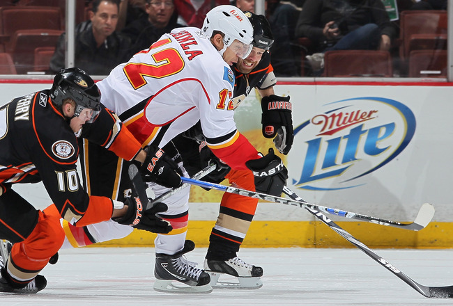 ANAHEIM, CA - DECEMBER 10:  Jerome Iginla #12 of the Calgary Flames is pursued by Corey Perry (L) #10 and Paul Mara #23 of the Anaheim Ducks at the Honda Center on December 10, 2010 in Anaheim, California.  (Photo by Jeff Gross/Getty Images)