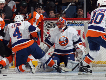 UNIONDALE, NY - DECEMBER 05:  Dwayne Roloson #30 of the New York Islanders tends net against the Philadelphia Flyers at the Nassau Coliseum on December 5, 2010 in Uniondale, New York.  (Photo by Bruce Bennett/Getty Images)
