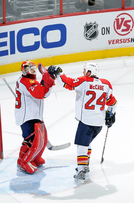 WASHINGTON, DC - DECEMBER 09:  Tomas Vokoun #29 of the Florida Panthers is congratulated by Bryan McCabe #24 after a 3-0 victory over the Washington Capitals at the Verizon Center on December 9, 2010 in Washington, DC.  (Photo by Greg Fiume/Getty Images)