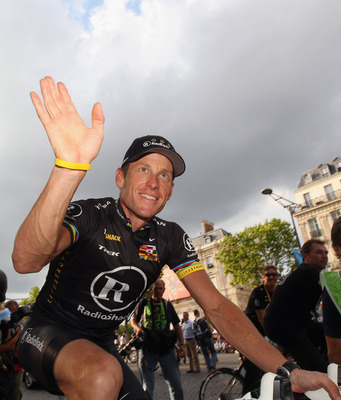 PARIS - JULY 25:  Lance Armstrong of team Radioshack waves to fans after the twentieth and final stage of Le Tour de France 2010, from Longjumeau to the Champs-Elysees in Paris on July 25, 2010 in Paris, France.  (Photo by Bryn Lennon/Getty Images)