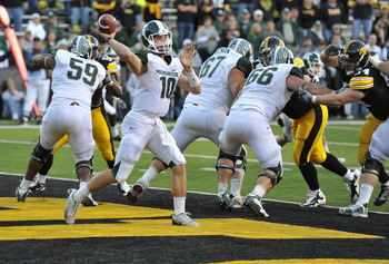 IOWA CITY, IA - OCTOBER 30- Backup Quarterback Andrew Maxwell #10 for the Michigan State Spartans throws under pressure from the Iowa Hawkeyes defense during the second half of play at Kinnick Stadium on October 30, 2010 in Iowa City, Iowa. Iowa won 37-6