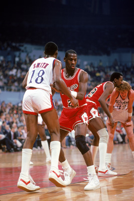LOS ANGELES, CA -  - DECEMBER 1984:  Michael Jordan #23 of the Chicago Bulls defends Derek Smith #18 of the Los Angeles Clippers during a December 1984 season game at the Sports Arena in Los Angeles, California.  (Photo by Rick Stewart/Getty Images)
